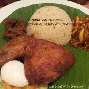 A fusion of Indian and Malay on a banana leaf rice meal