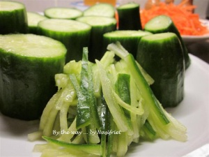 Evenly cut strips of cucumbers and carrot