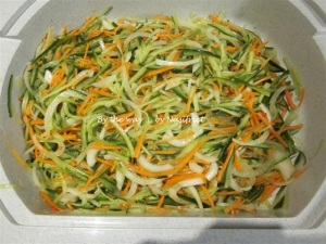 Salted strips of cucumbers, carrot, onion, garlic and chilli. Let stand for at least 2 hours